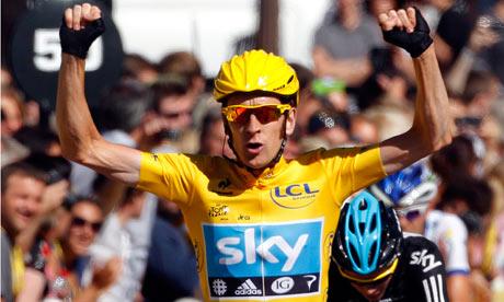 Bradley Wiggins celebrates on the finish line after winning the Tour de France