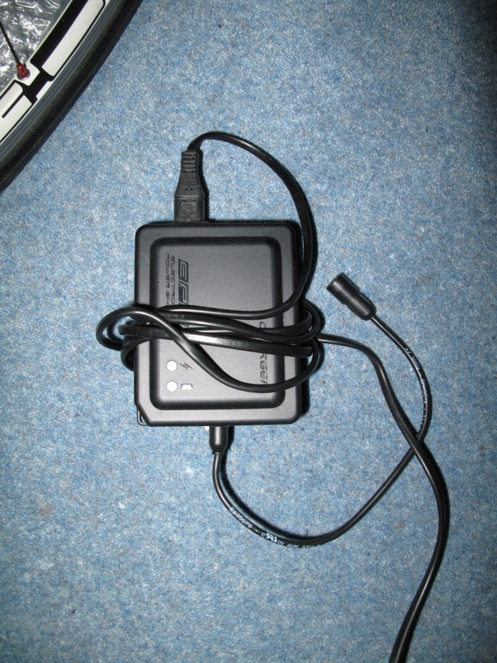 The rather large charger you get. Not that its size is much of an issue.
