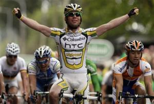 Team Columbia rider Cavendish raises his arms as he wins the second stage of the Tour of Ireland cycling race in Killarney