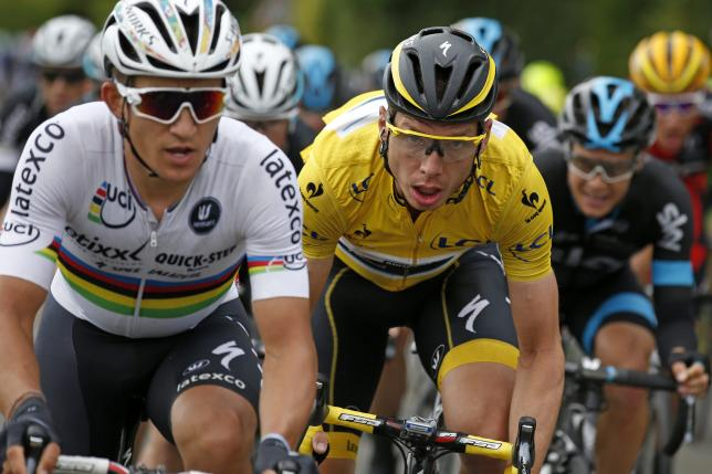 Etixx-Quick Step riders Michal Kwiatkowski (L) of Poland and Tony Martin of Germany, race leader's yellow jersey, cycle during the 189.5-km (117.7 miles) 5th stage of the 102nd Tour de France cycling race from Arras to Amiens, France, July 8, 2015. REUTERS/Benoit Tessier