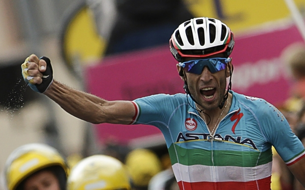 Italy's Vincenzo Nibali celebrates as he crosses the finish line at the end of the 138 km nineteenth stage of the 102nd edition of the Tour de France cycling race on July 24, 2015, between Saint-Jean-de-Maurienne and La Toussuire, French Alps.  AFP PHOTO / KENZO TRIBOUILLARDKENZO TRIBOUILLARD/AFP/Getty Images
