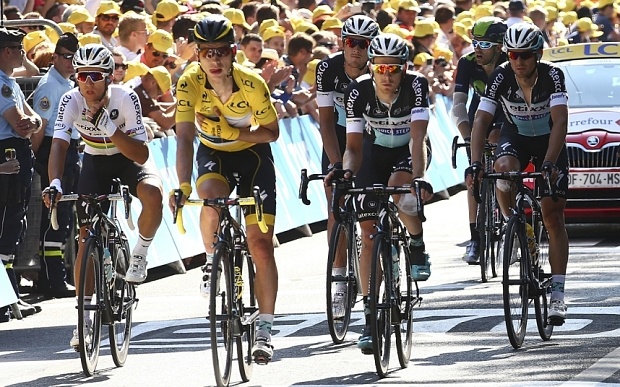 Germany's Tony Martin holds arm in a position which could indicate a broken collar bone after crashing in the last kilometers of the sixth stage of the Tour de France cycling race over 191.5 kilometers (119 miles) with start in Abbeville and finish in Le Havre, France, Thursday, July 9, 2015. (AP Photo/Peter Dejong)